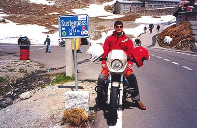 June 10, 1996 - Sustenpass, Switzerland.  The Sustenpass (2224 m asl) lies between the towns of Innertkirchen in the West and Wassen in the East. There are numerous very short tunnels to the West of the Sustenpass. One of the tunnels becomes a waterfall as water flows over it and into the valley below. While passing through this tunnel, a hole carved into the side enables you to look through the waterfall towards the scenery in the background.