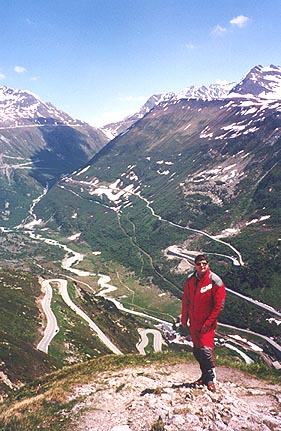 June 10, 1996 - Grimselpass, Switzerland.<br /> <br /> Directly behind me is the town of Gletsch in the valley below with the road leading up to the Grimselpass. In the background, the road leading up to the Furkapass.