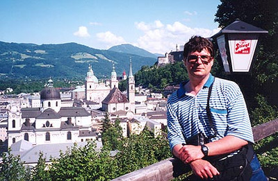 June 10, 1997 - Salzburg, Austria.  I am on Mönchsberg overlooking the old part of Salzburg. Directly behind me on the hilltop is a partial view of Festung Hohensalzburg (castle). There are numerous pathways on Mönchsberg that extend from the castle to beyond Cafe Winkler, the restaurant on the edge of the cliff pictured in the next photo.