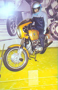 June 27, 1998 - BMW Museum, München, Germany.<br /> <br /> One of the numerous displays dedicated to the 75th anniversary of BMW motorcycles. I would consider the R90S as the only post 70s collectable. I do prefer the Silver Smoke over the Daytona Orange, pictured.