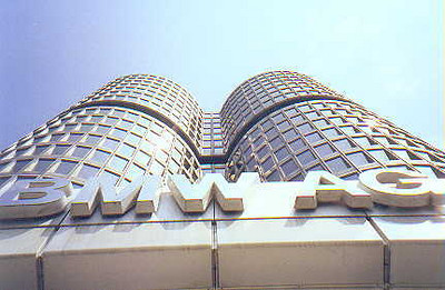 June 27, 1998 - München, Germany.  A slightly different view of BMW headquarters taken from the main entrance with my back pressed against the driveway. Its a good thing this was a Saturday or I would have had the front tire of the CEO's car on my forehead.
