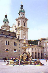 June 30, 1998 - Salzburg, Austria.  Residenzplatz in the old part of Salzburg. Those wishing to take a buggy ride through the streets of old Salzburg will find them here. They are parked in the background.