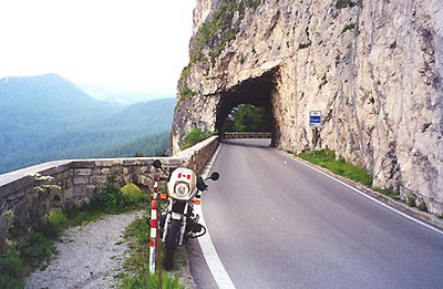 June 29, 1999 - Approaching Pocol, near Cortina d'Ampezzo, Italy.  The road through the tunnel near the town of Pocol hangs a sharp right when heading west. From the town of Pocol, you have the option of riding the horizontal figure eight loop of passes to the west which include Passo di Falzarego, Passo Pordoi, Passo Sella, Passo Gardena, Passo di Campolongo and Passo di Valparola, or heading south to ride passes such as Passo Giau, Passo Cibiana, Passo Duran, Passo di Cereda, Passo Rolle, Passo di Valles, Passo di San Pellegrino and Passo Fedaia.