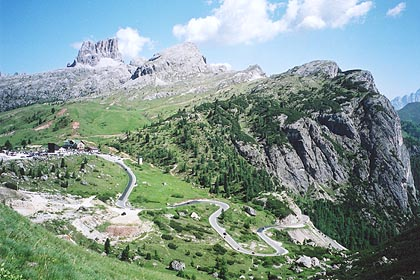 June 18, 2000 - Passo Valparola, Italy.<br /> <br /> This view of Passo di Falzarego (2117 m asl) was taken from Passo Valparola (2192 m asl). The road seen winding in the right of the photo is just up from the road in the previous photo above.
