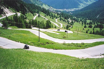 June 17, 2000 - Passo Gardena, Italy.  The view of Passo Gardena descending into the town of Corvara, Italy visible in the valley in the background.