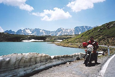 June 22, 2000 - Passo di Gavia, Italy.  The view just past the top of Passo Gavia approaching from the south. Although late into June, there was still snow to be found alongside the road on some of the passes.