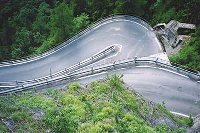 June 19, 2001 - Splügen Pass, Italy / Switzerland.  Another view of one of the many hairpins on the south approach to the Splügen Pass. The northbound run provides a tight turn if a southbound vehicle happens to be in the hairpin at the same time. Normally on the upward run, you would take it wide while looking up over your shoulder for downward traffic. If all is clear, you can continue to run wide, then cut in at the apex. If not, it is a tight one.