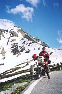 June 19, 2001 - Splügen Pass, Italy / Switzerland.  This view, taken from the same location as the previous photo shows the nice blue skies that I had during most of my tour. Earlier in the day when I had crossed this pass to ride the nearby Passo del San Bernardino and the Lukmanier, the pass was shrouded in cloud at a temperature of 8 degrees Celcius. Changing weather is something that one accepts when riding the Alps.
