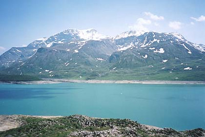June 24, 2001 - Lac du Mont Cenis, France.  Lac du Mont Cenis is located just southeast of the pass itself. Off the main road, there are numerous other dirt roads that lead to the far side of the lake as well as up the Col du Petit Mont Cenis, which strangely enough at 2182 m asl is higher than the Col du Mont Cenis at 2081 m asl. Go figure!