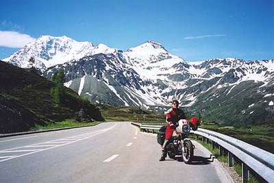 June 23, 2001 - Simplonpass, Switzerland.  The Simplonpass lies between the town of Domodóssola, Italy and Brig, Switzerland. This view was taken 200 meters south of the pass itself. The road behind me leads up to the pass ahead from the town of Domodóssola. More great scenery covered in crystal clear blue skies. This is becoming hard to take.