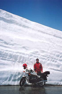 June 24, 2001 - Col de l'Iseran, France.  As late as it was in June, there was plenty of snow on the passes that exceed the 2000 meter mark. The vertically cut snow bank behind me was just over 12 feet high.