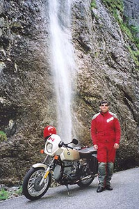 June 14, 2001 - Sottoguda gorge, Sottoguda, Italy.  The Sottoguda gorge is located between the towns of Caprille and Canazei on the road leading up to Passo di Fedaia. The one-way Sottoguda gorge road starts in the town of Sottoguda, and runs east to west. At one point, you'll notice a road high above the gorge making a crossing. This is the main road up Passo di Fedaia, if you hadn't taken the turn into the town of Sottoguda to take the gorge road. Once back on the main road, take a short drive back to the east through a tunnel where you'll find a parking area to stop at. From there, you can walk along the bridge and view the Sottoguda gorge from above.