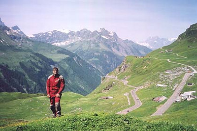 June 17, 2002 - Klausenpass, Switzerland.  The Klausenpass (1952 m asl) lies between the towns of Altdorf and Glarus in Switzerland. The road from Altdorf is the typical road you'd find in the Alps until you get to a very nice section that hugs the edge of the mountain and twists back and forth while climbing up to the pass itself. The last part of this section of road can just be seen ending in the center of the photograph.