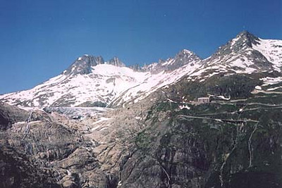 June 18, 2002 - Between the Grimsel Pass and Furka Pass, Switzerland.  The view up towards the Rhone Gletscher and Hotel Belvedere, both on the Furka Pass.