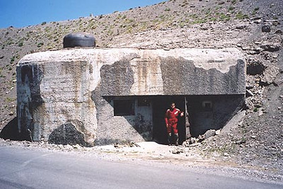June 22, 2002 - Col de la Bonette, France.  One of the bunkers I came across while approaching the Col de la Bonette from the north. Curiosity had me check out the inside which was flooded with water, but I did manage to make it to the window in the center of the structure. The steel door was quite solid.