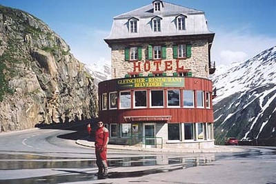 June 19, 2002 - Hotel Belvedere on the Furka Pass, Switzerland.  Just down from the Furka Pass itself, at the Rhone Gletscher, Hotel Belvedere is pinned within the hairpin turn leading down into the valley towards the town of Gletsch. Ahead of me lies ample parking next to a souvenir shop and the starting point for a walking tour of the ice caves within the Rhone Gletscher (glacier).