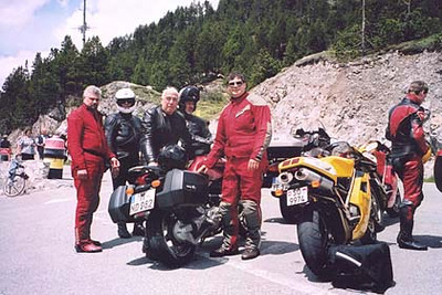 """June 13, 2002 - Ofenpass, Switzerland.  Just as I was pulling into the parking lot of the Ofenpass (2149 m asl), another rider came up from behind asking me who I was. I never forget a face and I think John Hermann may have been a bit surprised that I recognized him. John is pictured standing next to me and was joined by three other riders from the US. John is the author of """"Motorcycle Journeys Through the Alps and Corsica"""", one of the few books on this subject in the English language."""