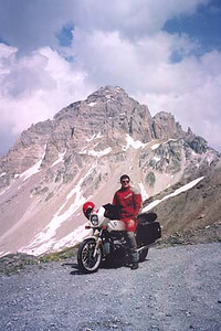June 21, 2002 - Col du Galibier, France.  There are two ways across the Col du Galibier (2645 m asl).  Just below the pass itself, the Tunnel du Galibier (2556 m asl) takes one through a few hundred meters of mountain. Since the tunnel is a single lane, traffic alternates, signaled by a traffic light. The actual route to the pass branches off from the tunnel road and twists itself up and down the mountain to meet up on the other side of the tunnel. This photo was taken 400 meters up the north ramp of the pass road from the tunnel.