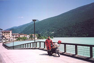 June 11, 2002 - Lago di Barcis, Italy.  Heading east on route 251 from Longarone over Passo di San Osvaldo (842 m asl), takes you past the town of Barcis lying on Lago di Barcis. Yes, the water is that colour.