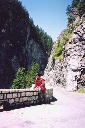 June 14, 2002 - Albula Pass, Switzerland.<br /> <br /> Portions of the north ramp of this pass road hugs the edge of the mountain high above the gorge below. The road behind me is the norm as far as the width goes. There is the odd area where one can park to take in the views. Not a stretch that you'd want to make a mistake on.