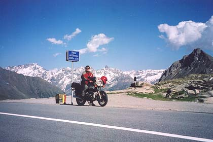 June 14, 2002 - Passo del Bernina, Switzerland.<br /> <br /> Passo del Bernina (2330 m asl) lies between the towns of Pontresina and Poschiavo in Switzerland. Just east of the pass, a road tees off to the north and leads over Forcella di Livigno (2315 m asl) into the town of Livigno. Livigno is where I've made my home base twice so far simply because of its location and also because it is a tax free zone. Gas prices are roughly half of what they are anywhere else. From Livigno, the Malojapass, Julierpass, Albulapass, Fluelapass, Ofenpass, Passo d'Eira, Passo di Foscagno, Pass Umbrail, the Stilfser Joch and Passo di Gavia are easily reached during day rides.