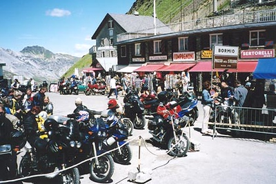 June 21, 2003<br /> Passo dello Stelvio a.k.a. the Stilfser Joch, Italy.<br /> <br /> 1996 was the last time I drove up the Passo dello Stelvio (2758 m asl). Since then, numerous opportunities arose to cross this pass again while en-route to another area. Unfortunately, every time I tried, the pass was closed due to either an earth slide or snow cover. Nothing has changed; still a great pass to ride. Just a few kilometers towards Bormio, one has the choice of taking the Umbrailpass (2503 m asl) into the town of Santa Maria i. Münstertal, Switzerland. There are 2.6 kilometers of gravel road along this route.