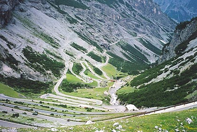 June 19, 2003 Passo dello Stelvio a.k.a. the Stilfser Joch, Italy.  The west ramp of this pass road offers 39 hairpins for your riding pleasure before arriving in the town of Bormio, Italy. There are also a few tunnels along the way.