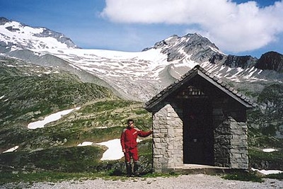 June 13, 2003<br /> Pfitscher Joch, Austria - Italy.<br /> <br /> I did manage to make it up the Italian side to the Pfitscher Joch (2275 m asl), even though it is closed to motorized traffic. The paved road from Sterzing, Italy ends just past the small town of Stein. From there, 10.5 kilometers of gravel road leads to the top of the pass. It was at the gate across the road where I met two officials from the Guardia di Finanza, that eventually let me take the drive up the road as long as I took it slow. Taking in the magnificent scenery into the valley below and stopping for a few photos along the way, I waved them through in their 4WD as I was going slower than they expected. I spent the night before in Mayrhofen, Austria, a town in the valley that leads up to this same pass, but from the Austrian side.