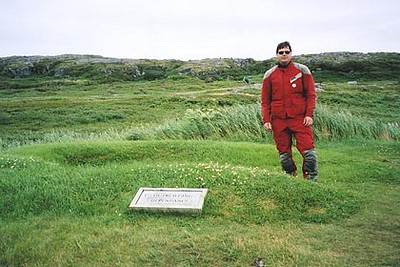 August 18, 2003 L'Anse aux Meadows, Newfoundland.  The Norse discovered the New World some 500 years before Christopher Columbus even set sail. I am standing in an area where the original excavations took place in the early 1960s. There are several mounds where the original buildings once stood.