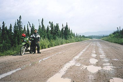 August 22, 2003 16 kilometers north of Manic Cinq, Quebec.  The 380 kilometer section of  road between Labrador City, Labrador and Manic Cinq alternates between pavement and gravel, of which 237 kilometers are gravel. There are short sections of gravel road that are fairly twisty; the first section immediately south of Fermont and the other, 30 to 40 kilometers north of Manic Cinq. Other than those section, the road is quite straight with some elevation changes.