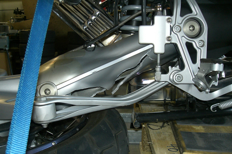 It appears that the driveshaft peeled open the underside of the swingarm casting.