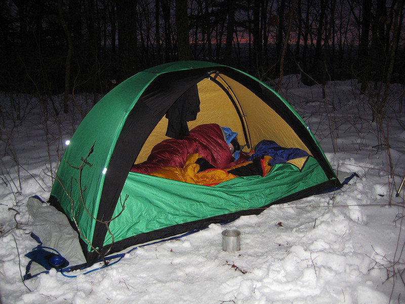 """As we lay there, we heard this metallic sound coming from the direction of the trail, a faint clanking noise. The noise got louder and  then faded away. I figured whoever made those tracks came back down the trail on their way out.  Maybe 15 minutes later the """"clank"""" was back. """" Now why would they go down the trail in the dark and then come back up again?"""", I wondered. It was a good two miles down the mountain to their jeeps.  It moved up the trail and back down and at one point seemed to be in woods very close by.  Again, the clank faded."""