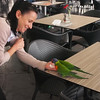 At lunch on the harbor.  These parrots evidently love sugar.  At one coffee shop I sat outside and they would come in and steal sugar packets from the tables and fly off with them.  Here my waitress feeds them out of her hand.