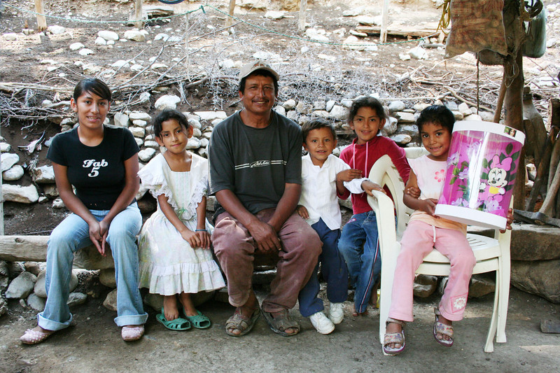 Eulogico Sanchez and his extended family, Reforma. <br /> The children were dressed special for this picture. The one little girl brought out her favorite toy, still wrapped in plastic.