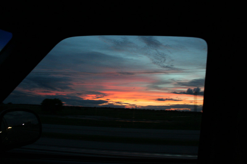 One handed shot of July 4th sunset out car window while driving I-35, south of San Marcos, Texas
