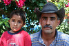 One of Romero's brothers, with his child, Purisima