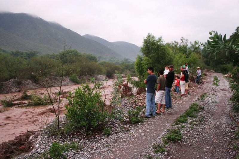 Onlookers gawking at the swollen Blanco river running thru Aramberri