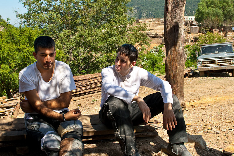 Roberto and Jarrett relaxing on wooden planks in the sawmill town of Buena Vista