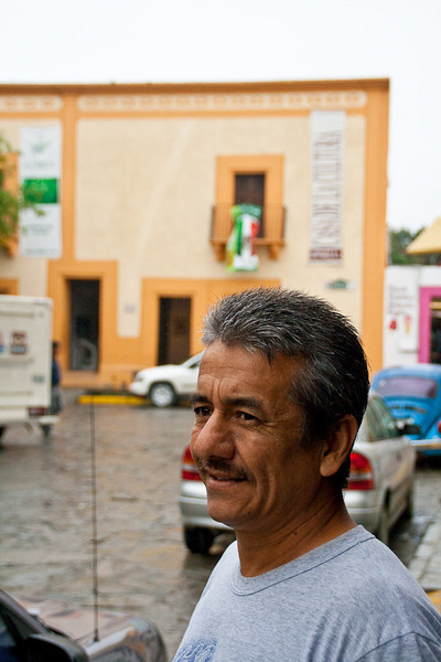Miño, the guy who proudly showed me around the oldest house in Santiago, which you see in the background.