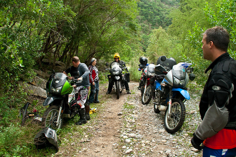 "Another wet plug, another tear down. We had 3 that day. Deloris, the only woman attending MexTrek 2009, made this ride. She was an inspiration to a lot of us. <br /> ""Hey Milton, do you want to turn back?""<br /> ""Hell no I'm not turning back, that girl is up ahead.""<br /> The group of 10 natually split up into teams of 5. <br /> Shadman Pete, on the right, apparantly was born on a motorcycle. It seemed he was the only one of the group completely comfortable with his surroundings. There was an interesting display of team work going on but this guy made the ride a success. Here he stands back and lets Deloris's team do their thang."