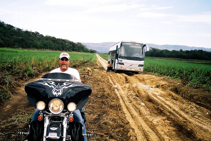 A bus stuck out in the middle of nowhere due to bad roads is always a bad sign.  Harley miester Clayton forges fearlessly ahead.  (the rd to Minas Viejas falls)