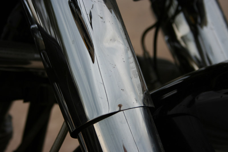 Damage to Clayton's bike, bent fork sleeve