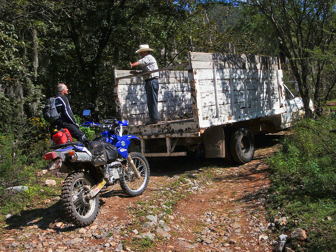"""Asking directions near Alamar.  GPS technology threatens to do away with one of my favorite parts of adventure riding. Asking directions.  Another photo I didn't take. Photo courtesy of <a href=""""http://advrider.com/forums/showpost.php?p=8258435&postcount=95""""><strong><span style=""""color:#5DFC0A"""">Anja</span></strong></a>"""