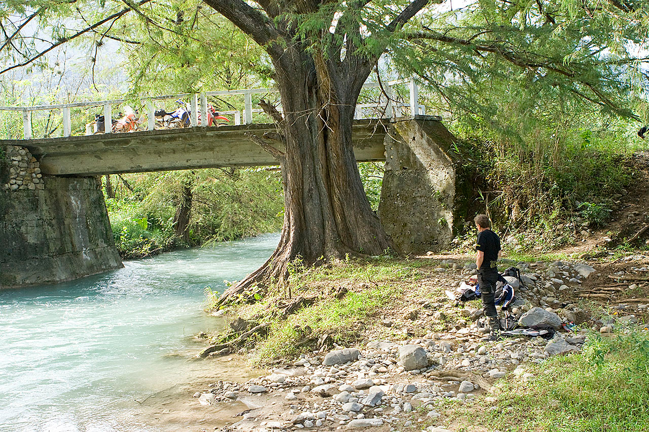 "Lunch at the San Antonio River.<br /> <br /> Gearing up on the bridge after lunch Joe says, ""San Antonio River.""<br /> <br /> His GPS (which up 'till now had been essentially blank) put us on the San Antonio River. Hummmmm. I looked at my map.<br /> Nothing? Nothing.<br /> No wait, San Antonio River, and there's Alamos. <br /> We were no where near where I thought we'd be, exiting the mountains, headed towards Hwy 85 and the long slab back to Galeana."