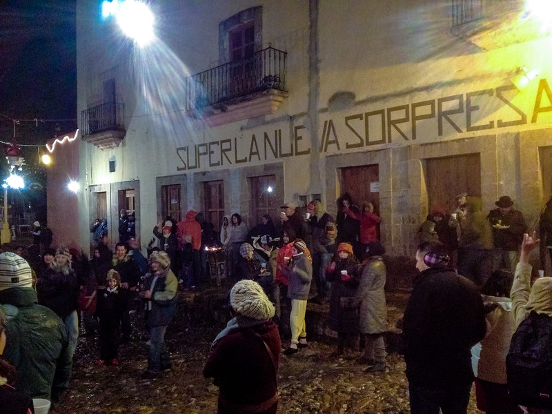 One of Scott's photos. The impromtu New Year Eve's street party in Real de Catorce. <br /> Can you spot the two gringos sipping hot cider on the side walk?