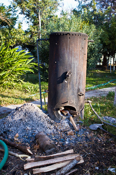 This is the wood burning boiler, our hot water heater, in Aramberi. <br /> Actually this set-up is fairly common for this area.