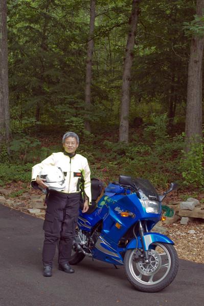 Me posing next to my blue Ninja.