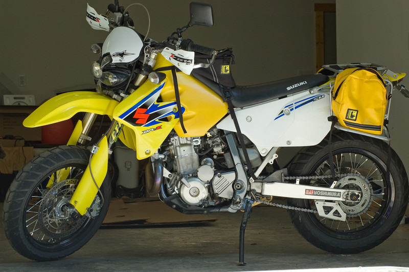 Lisa's 2006 DRZ400SM.  Acerbis Cyclops headlight and Zeta handguards.  Ignore the hanging straps on the tank bag and panniers - I hadn't trimmed them when I snapped this pic.