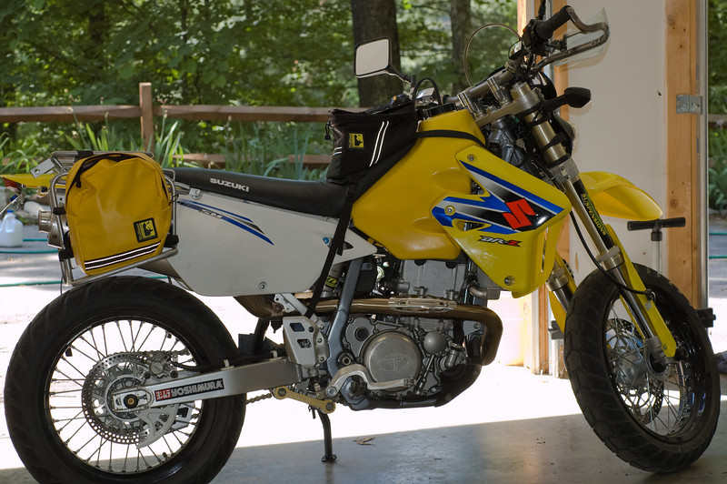 Lisa's 2006 DRZ400SM - now a supercommuter with Wolfman tank bag, tank panniers (mounted on Turbo City Safari rack), and Zeta handguards.  And last but not least, lowered by CTR Suspensions of Knoxville, TN.
