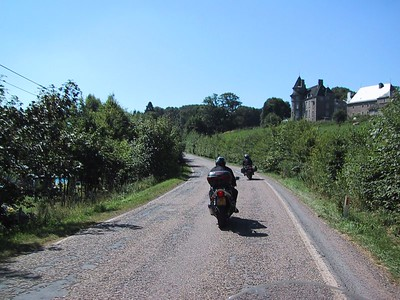 Bumpy local roads twist thru rural, green hills with a few castles and near dead villages.